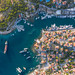 Aerial view of Mediterranean villas and ships in the port of the Saronic Island Spetses in the Argolic Gulf, Greece