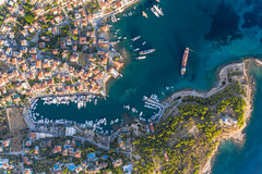 Aerial view of the Mediterranean island Spetses, Greece, with coastal path and anchorage in the Argolic Gulf