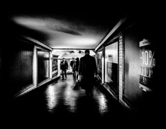 -10%.jpg (Klaus Ressmann) Tags: klaus ressmann omd em1 fparis france peoplestreet subway winter blackandwhite candid corridor flcpeop man poster streetphotography unposed klausressmann omdem1