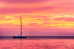 Sunset Boat (Wits End Photography) Tags: sand color sunset seashore water clouds evening coastal sea ocean dusk shore beach maritime nautical coastline colorful objects twilight sky boat costarica vehicle marine seaside cloudy colors multicolored