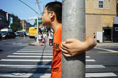 Pole (dtanist) Tags: nyc newyork newyorkcity new york city sony a7 7artisans 35mm brooklyn sunset park 8th avenue chinatown pole hand child boy kid