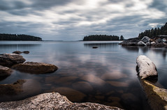 Low water (mabuli90) Tags: finland lake water forest tree sky clouds longexposure reflection rock landscape nature blue