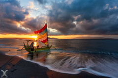 Gone Fishing (DanielKHC) Tags: indonesia east java boat fisherman sunrise waves clouds nikon z7 nikkor z 1430mm banyuwangi sun flare