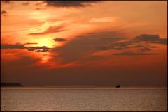 The North Coast. (ikerr) Tags: sunset sea ship sky orange red yellow portrush north coast atlantic ocean northern ireland