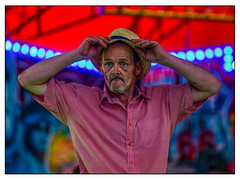 Speed king (Photography And All That) Tags: nottingham nottinghamriversidefestival 2019 speedway fair fairground ride colours lights music whitephotoborder portrait portraits portraiture candid candids man person men character gaze hat hats colour colourful docbrown sony sonyalpha7mark3 sonyalpha sonyilce7m3 canonlens 70200 metabones adaptor