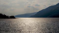 Light on the Loch (San Francisco Gal) Tags: loch scottishhighlands sky cloud water light hills scotland