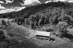We'll build a barn at the foot of a hill that only few will remember (John Westrock) Tags: clouds background barn blackandwhite djimavicpro2 dronephotography farm horizontal johnwestrock landscape midwest monochrome rural sky trees wallpaper wisconsin unitedstatesofamerica
