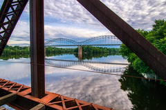 Providence & Worcester railroad bridge #4 (tquist24) Tags: arringonibridge connecticut connecticutriver hdr middletown nikon nikond5300 outdoor providenceworcesterrailroadbridge clouds geotagged industrial outside rail railroad railroadtracks rails reflection reflections river sky steel swingbridge tracks traintracks trees trussbridge water