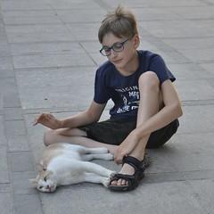 I Love Cats (t.horak) Tags: cat boy child sitting lying street ginger cute cuddling glasses hand love