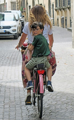Riding with Mom - Lucca, Italy (TravelsWithDan) Tags: candid street motherandson bicycle riding cobblestones tuscany lucca italy facingbehind glasses city urban europe canong3x