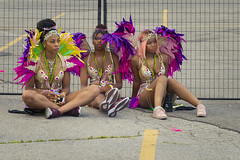 Resting after the Grand Parade (A Great Capture) Tags: agreatcapture agc wwwagreatcapturecom adjm ash2276 ashleylduffus ald mobilejay jamesmitchell toronto on ontario canada canadian photographer northamerica torontoexplore summer summertime été sommer 2019 caribana caribbeancarnival tocarnival costumes resting fence end day feathers parkinglot streetphotography candid canon eos 6d mark ii ef2470mm outdoor outdoors outside vibrant colorful cheerful vivid bright colours colors colourful