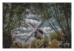 Mill Framing (Bob Geilings) Tags: kinderdijk netherlands travel rotterdam nature photography unesco nederland landscape travelphotography kinderdijkmills dutch beautiful unescoworldheritage clouds frame holland windmill