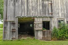 Barn Details (Neal3K) Tags: wclx10028mmlens bettendorfiowa iowa nearbettendorfiowa barn weathered wood gray texture rustyhinges zdoor