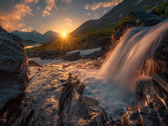 A Parable of Light (Ole Henrik Skjelstad) Tags: water sunrise sun mountains river waterfall norge norway lake rocks snow