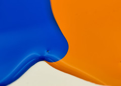Watching Paint Dry (Helen Orozco) Tags: macromondays complementarycolours orangeandblue paint spilled orage blue macro blobs