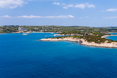 Areal view from the sea to Chenesar Island and Aks Hinitsa Bay Hotel in Chinitsa, Greece
