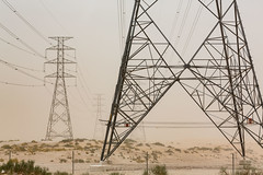 Electric power towers during a dust storm (Waleed (@65WZ)) Tags: alahsa الإحساء saudiarabia المملكةالعربيةالسعودية electrictowers powertowers transmissiontowers