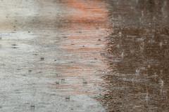 splashes (ToDoe) Tags: water rain rainy orange splash spritzen spritzer regentropfen drops asphalt strasse wasser platzregen reflection reflexion spiegelung bokeh dof