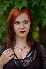 Redhead beauty (piotr_szymanek) Tags: minerwa woman young skinny face portrait outdoor redhead green leaves necklace transparemt lingerie 20f 1k 5k 50f 100f 10k bestportraitsaoi 20k