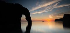 Durdle door sunset (paullangton) Tags: sunset durdledoor dorset sun clouds sea coast jurassic headland beach arch warm colour longexposure leefilters rocks reflections landscape seascape 5dmk3 silhouette