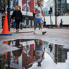 Color Coordinated (Sean Batten) Tags: london england unitedkingdom streetphotography street reflection person candid shorts water puddle shoreditch eastlondon fuji fujifilm x100f
