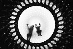 Life, but not as we know it. (markfly1) Tags: london england uk kew gardens children playing candid image through glass floor street photography black white mono monochromatic pattern patterns circulat mesh steel repeating lines bright light hive art installation funny scene nikon d750 35mm manual focus lens