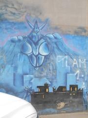 792 (en-ri) Tags: mostro monster blu cielo sky edifici buildings savigliano cuneo graffiti writing wall muro