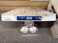 Amazin' Memorabilia Store at Citi Field, 07/27/19 (NYM v PIT): Pete Alonso is so great that three of his signed baseballs are all that's needed to keep this game-used base propped up at an angle (okay, not really... just having some fun) (IMG_7865a) (Gary Dunaier) Tags: baseball stadiums stadia ballparks mets newyorkmets flushing queens newyorkcity queenscounty queensboro queensborough citifield polarbear