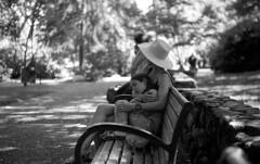 Listening (bingley0522) Tags: leicaiiic zeissjenasonnar50mmf15ltm trix hc110h epsonv500scanner ashlandoregon lithiapark parkbench listeningtothecello saturdaymorning peaceful motheranddaughter autaut