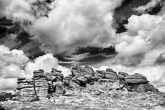 Cloudscape versus landscape (Christian Hacker) Tags: houndtor blackandwhite bw dartmoornationalpark rockformations graniteoutcrops rocky landscape cloudscape clouds canon eos50d tamron 1750mm devon uk outandabout familyadventure