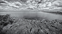 Vanishing To A Certain Point (Alfred Grupstra) Tags: blackandwhite nature sea coastline beach landscape water scenics outdoors cloudsky sky seascape nopeople rockobject watersedge monochrome cloudscape beautyinnature horizonoverwater wave dissapearingpoint