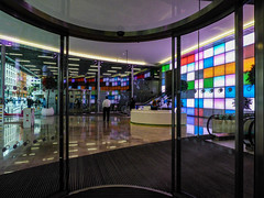 The Explosives Industry Group (Steve Taylor (Photography)) Tags: explosivesindustrygroup eig cannonstreet lobby mosaic esculator architecture design colourful glass metal man uk gb england greatbritain reception desk unitedkingdom london glow perspective reflection