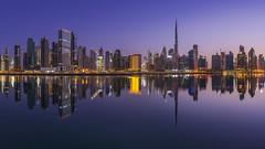 Business Bay Sunrise (Bereno DMD) Tags: dubai city arab unitedarabemirates metro metropolitan urban east arabian reflection sunrise sunset water symmetry river business businessbay widescreen panoramic pan pano panorama panoramicshot nikon nikond850 fullframe pretty beautiful light lights emirates gulf uae burj burjkhalifa travel travelphotography bucketlist