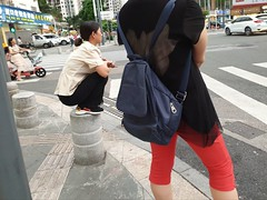 Balance (Whistler Whatever) Tags: shenzhen china flaneur woman squat bollard pedestal waiting intersection trafficlight redlight chinese everyday guangdong