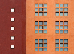 Bilbao in Squares (HWHawerkamp) Tags: architecture building windows bilbao spain facade wall orange red geometry symmetry graphic