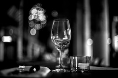 bokeh doesn't fill the glasses (Gerrit-Jan Visser) Tags: hem blackandwhite bnw bokeh glasses light reflections dining diner empty mood vague ambiance shine wine restaurant pov helios 442 58mm f2 soul essence