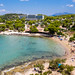 Aerial view shows holidaymaker at Hinitsa beach and restaurant, at the coast of Argolic Gulf in Ermionida, Greece