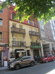 Calle Cartagena, La Guindalera, Madrid (d.kevan) Tags: callecartagena streetscene buildings balconies plants bars restaurants laguindalera madrid cars people signs windows doors architecturaldetails decorativedetails pillars arches trees metalwork doorways