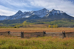 Last Dollar Ranch (Jim Johnston (OKC)) Tags: lastdollarranch doublerl mtsneffels fence snowcappedmountains aspens clouds lastdollarroad sanjuanmountains dallasdivide coloradoriver