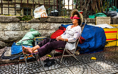 Relaxing time Vietnamese style (Phg Voyager) Tags: saigon hochiminhcity vietnam asia sleep lady girl leica mp 24mm summilux street urban city photography phgvoyager color outdoor summer hot pathway urbanscape life streetphotography conic hat nonla conicalhat iconic