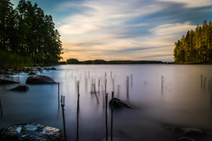 Viitasaari (mabuli90) Tags: lake water forest tree sky clouds longexposure rock grass finland summer