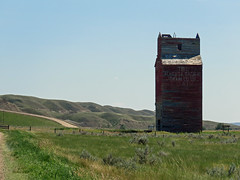 Still standing, tall and proud (annkelliott) Tags: canada alberta neardrumheller neofcalgary road old summer building abandoned nature canon landscape dorothy wooden scenery outdoor elevator structure powershot hills weathered badlands grainelevator sentinel ruralscene annkelliott sx60 anneelliott canonsx60 albertaicon nearghosttown 5august2019