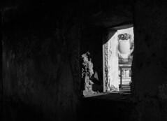 Art beyond the window (Darea62) Tags: decay blackandwhite arms sculpture monochrome abandoned angel light bw dark wall window ancient azzano seravezza versilia biancoenero mood