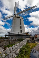 Blennerville Windmill (ivanstevensphotography) Tags: windmill sea water wall stone clouds colour foliage