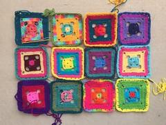 The first dozen Flamboyant Afghan granny squares (crochetbug13) Tags: crochet crocheted crocheting crochetsquares grannysquares grannysquareafghan crochetafghan crochetblanket grannysquareblanket