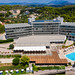 Aerial view of the beach hotel Aks Hinitsa Bay in Chinitsa, Greece, with swimming pool and solar plant on the roof
