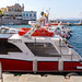 Water taxis in the Greek port on a side sea of the Aegean Sea, for island hopping for tourists and locals