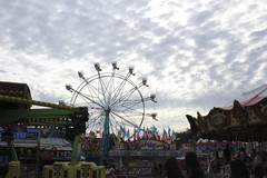 Not the Boardwalk (elephantsinlove) Tags: fair 2019 sonoma county santa rosa ca california fun joy rides ferris wheel cakes cones games west white speckled sky clouds cloud flags carousel lights color colors colorful photoshop edited cloudy green photography photos photo photograph fairgrounds august summer