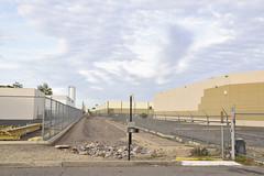 South Phoenix Industrial Park (GC_Dean) Tags: phoenix arizona sky clouds warehouse railbed fence street emptiness mundane city cityscape urban urbanlandscape sociallandscape space colors color colours structure building