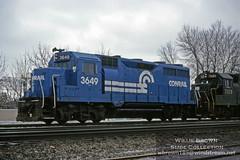 Conrail GP35 3649 leading a GP38 on a dreary winter day in 1979. (Willie - Brown) Tags: williebrownslidecollection conrail gp35 reading